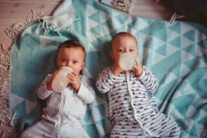 Babies drinking from bottles