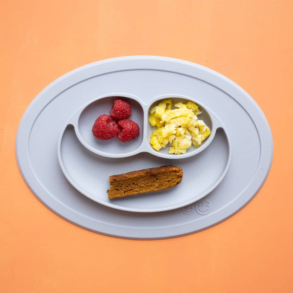 Balanced baby meal: raspberries, scrambled eggs, and biscotti