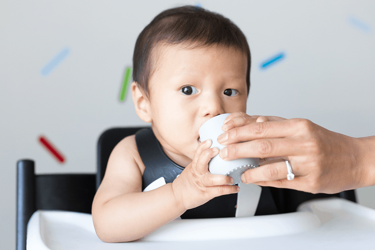 6 month old baby drinking from tiny cup