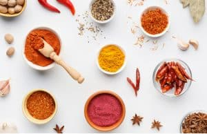 bowls of indian spices on a white background